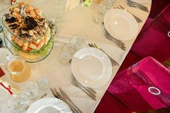 Wedding table with plates Royalty Free Stock Photography