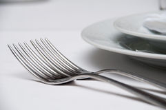 Wedding table with plates and spoons and forks Royalty Free Stock Image