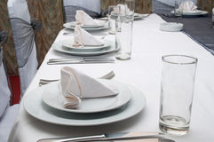 Wedding table with plates and spoons and forks Royalty Free Stock Photo