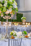 Wedding Table Preparations. Wedding Party Tables with Fancy Decorations - Flowers, Food, Lit Candles  and Silverware are Ready to Accept Guests for a Celebration Royalty Free Stock Photo