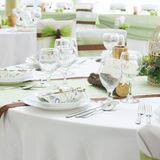 Wedding table set with decoration for fine dining or another catered event Royalty Free Stock Image