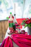 Wedding table set for fine dining or another catered event in red colors Stock Images