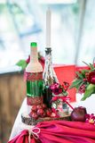 Wedding table set for fine dining or another catered event in red colors Stock Photography