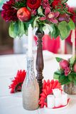 Wedding table set for fine dining or another catered event in red colors Stock Photo