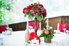 Wedding table set for fine dining or another catered event in red colors Stock Photos