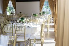 Wedding table sets in wedding hall. wedding decorate preparation. table set and another catered event dinner,. Luxury wedding table setting for fine dining at royalty free stock image
