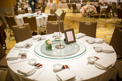 Wedding table sets in wedding hall. wedding decorate preparation. table set and another catered event dinner. Luxury wedding table setting for fine dining at Stock Photography
