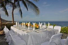 Wedding table setting 1. Table setting for wedding with ocean in the back ground royalty free stock image