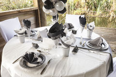 Wedding table setting 10. Outdoor wedding table setting idea in a boathouse Stock Photo