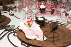 Wedding Table Setting. With rusted colors and pink flowers Stock Photography