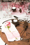 Wedding Table Setting. With rusted colors and pink flowers Stock Photos