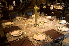 Wedding Table Setting. With rusted colors and bamboo decor Royalty Free Stock Photo