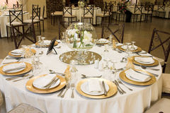 Wedding Table Setting. With golden coloured plates Stock Photos