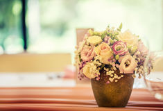 Wedding table setting. Beautiful table set with flowers and glass cups for some festive event, party or wedding reception.  stock photo