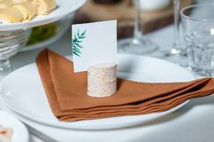 Wedding table setting with blank guest card on a dish. Rustic de. Cor in brown tones Stock Images