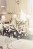 Wedding table setting with classic chairs, elegant floristics decoration in banquet restoraunt. The floral composition Royalty Free Stock Image