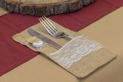 Wedding Table Setting Cutlery With Burgundy and Brown Table Cloth. stock images