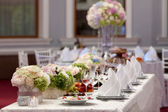 Wedding table setting decorated in the restaurant Stock Photos