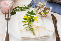 Wedding table setting, elegant, white yellow flowers, green leav. Wedding or engagement table setting, elegant, white yellow flowers, green leaves, burning Royalty Free Stock Images