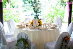 Wedding table setting with flower decoration Stock Photography