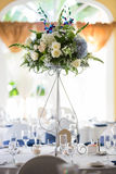 Wedding table setting. Wedding reception or banquet table setting with large floral centerpiece Royalty Free Stock Image