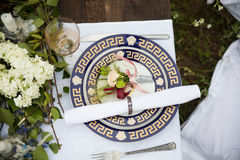 Wedding table setting in rustic style. Stock Image