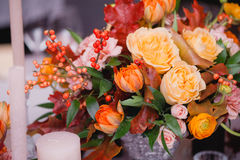Wedding table setting in rustic style. Elegant festive table setting with colorful flowers, cutlery, candles. Wedding table decoration Stock Images