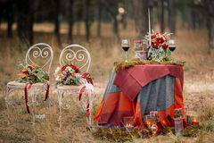 Wedding table setting in rustic style. Royalty Free Stock Photo