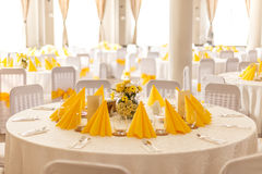 Wedding table settings. With yellow napkins Royalty Free Stock Images