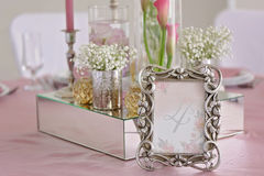 Wedding table with the sign number. In the background calla flowers close up Royalty Free Stock Photo