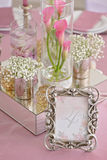 Wedding table with the sign number. In the background lily flowers close up Royalty Free Stock Photo