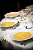 Wedding table with soup. Appetizer bowl of soup during a catered wedding event Royalty Free Stock Photo