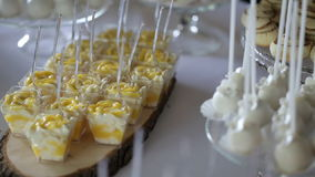 Wedding table with sweets and cakes stock footage