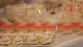 Wedding table with sweets and cakes, pastries sweets stock video