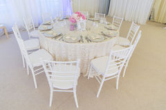 Wedding table. In a tent prepared for a wedding stock image