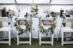 Wedding table under tent, with Mr and Mrs signs Royalty Free Stock Photo