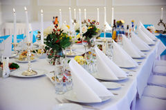 Wedding table with white napkins. Royalty Free Stock Photography
