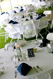 Wedding tables with blue napkins stock photography