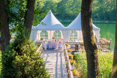 Wedding tables decorated outdoors in forest stock photo