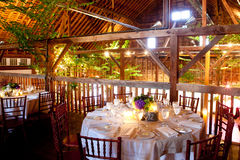 Wedding tables inside a rustic barn Stock Image