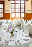 Wedding tables with  and orchid centerpiece. A purple orchid flower centerpiece on a white wedding table Stock Photo