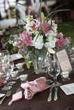 Wedding tables set for fine dining. Tables set for fine dining during a wedding event. Shallow depth of field Royalty Free Stock Photo