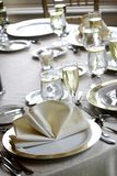 Wedding tables set for fine dining. Tables set for fine dining during a wedding event. Shallow depth of field Stock Photography