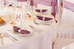 Wedding tables set for fine dining or another catered event Royalty Free Stock Photos