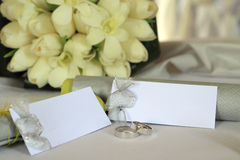 Wedding tags. And rings on the table Stock Images