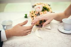 Wedding talk in restaraunt. Touching hands love couple over coffee cup in restaraunt stock photo