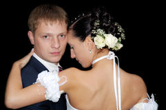 Wedding tango. Pair of sweethearts isolated on black Royalty Free Stock Image