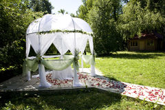 Wedding Tent. White wedding tent with table in summer green park Royalty Free Stock Photography