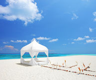 A wedding tent on a beach in Maldives. A view of a wedding tent on a beach in Maldives Royalty Free Stock Photo