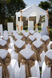 Wedding tent with chairs on lawn Stock Image